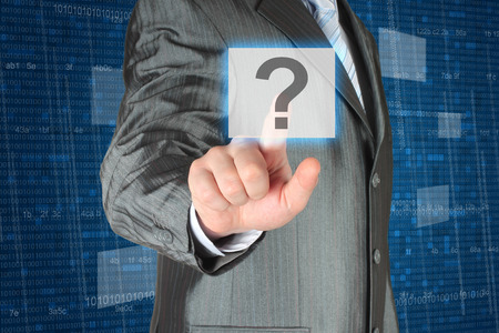 why: Businessman pushing virtual question button on digital background