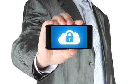 mobile security: Man holds smart phone with cloud security concept on white background  Stock Photo