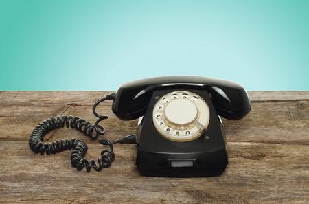 Retro telephone on wooden table  photo