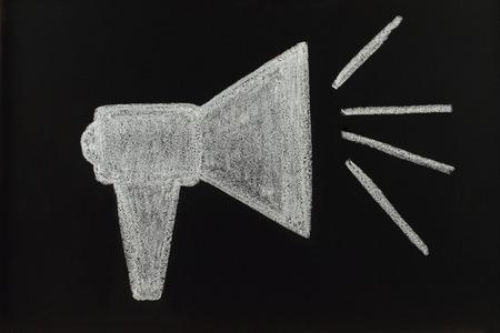 Chalk megaphone drawn on blackboard  photo