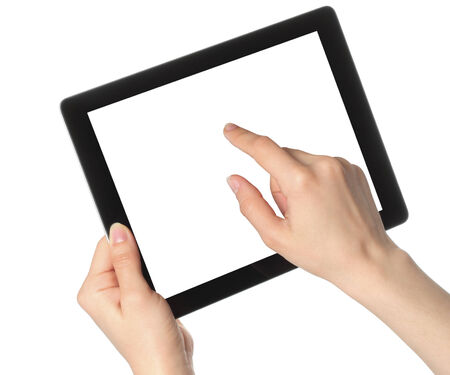 Woman hands hold and touch tablet PC on white background photo