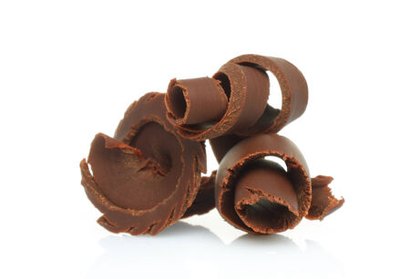 Chocolate shavings on white background photo