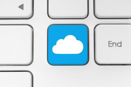 Cloud computing concept on computer keyboard photo