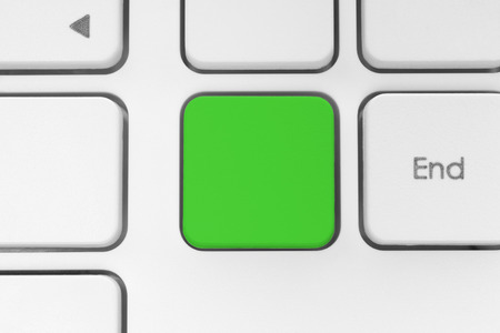 green: Blank green button on the keyboard close-up