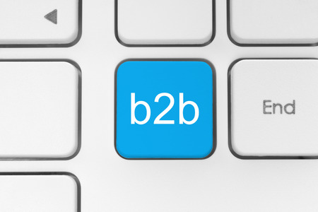 Blue B2B (business to business) button on keyboard close-up photo
