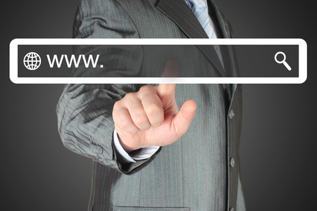 searchbar: Businessman pushing virtual search bar on black background, internet concept