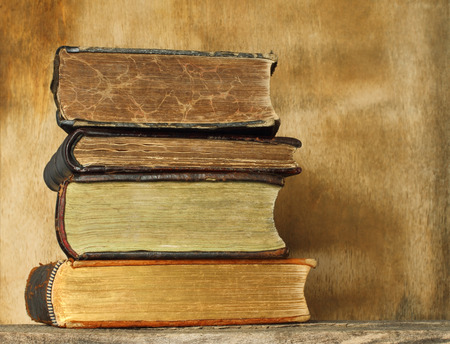 ancient books: Ancient books on wooden background