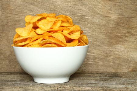 potato chip: Potato chips bowl on a wooden background Stock Photo