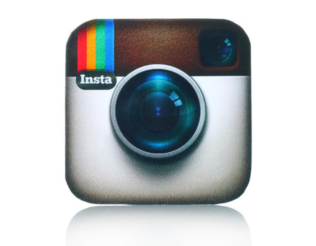 KIEV, UKRAINE - FEBRUARY 05, 2015:Instagram logotype camera printed on paper and placed on white background. Instagram is an online mobile photo-sharing, video-sharing and social networking service. Imagens - 37181945