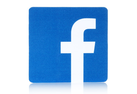 KIEV, UKRAINE - FEBRUARY 16, 2015: Facebook logo sign printed on paper and placed on white background. Facebook is a well-known social networking service. Imagens - 37181951