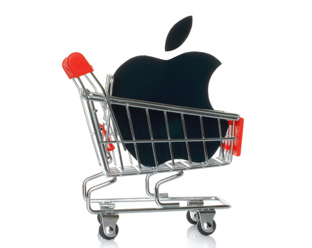 consumer electronics: KIEV, UKRAINE - JANUARY 16, 2015: Apple logotype printed on paper and placed into shopping cart. Apple is an American multinational corporation, that sells consumer electronics and personal computers.