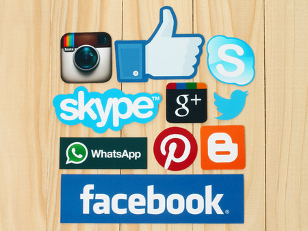 sign: KIEV, UKRAINE - FEBRUARY 19, 2015:Collection of popular social media logos printed on paper:Facebook, Twitter, Google Plus, Instagram, Skype, WhatsApp, Pinterest and Blogger on wooden background