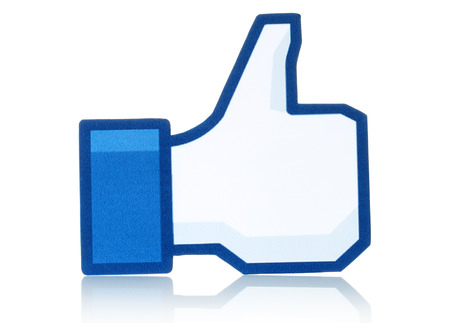 social networking service: KIEV, UKRAINE - FEBRUARY 19, 2015:Facebook thumbs up sign printed on paper and placed on white background. Facebook is a well-known social networking service.