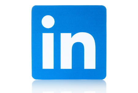 KIEV, UKRAINE - FEBRUARY 19, 2015: Linkedin logo sign printed on paper and placed on white background. Linkedin is a business social networking service. Imagens - 37759339