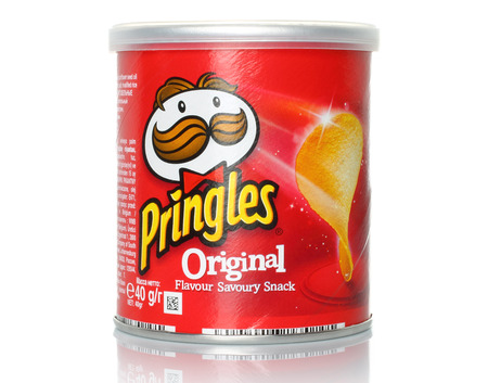 stackable: KIEV, UKRAINE - FEBRUARY 21, 2015:Pringles original potato chips on white background. Pringles is a brand of potato snack chips owned by the Kellogg Company.