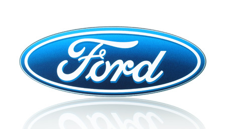 KIEV, UKRAINE - MARCH 21, 2015: Ford logo printed on paper and placed on white background. Ford Motor Company is an American multinational automaker.