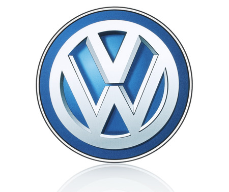 KIEV, UKRAINE - MARCH 21, 2015: Volkswagen logo printed on paper and placed on white background. Volkswagen is a German automobile manufacturer.