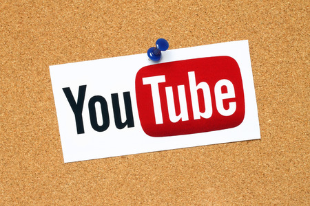 KIEV, UKRAINE - APRIL 15, 2015: YouTube logotype printed on paper and pinned on cork bulletin board. YouTube is a video-sharing website.