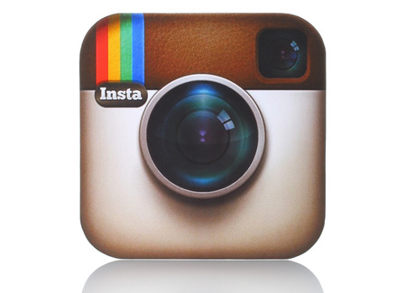 share information: KIEV, UKRAINE - APRIL 29, 2015:Instagram logotype camera printed on paper and placed on white . Instagram is an online mobile photo-sharing, video-sharing service.