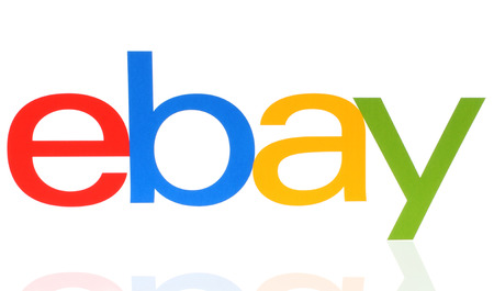 paypal: KIEV, UKRAINE - MAY 07, 2015:eBay logotype printed on paper on white background. eBay Inc. is an American multinational corporation and e-commerce company, providing sales services via Internet
