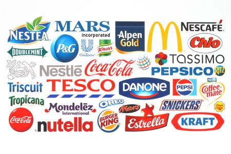 KIEV, UKRAINE - MAY 07, 2015:Collection of popular food logos companies printed on paper:Coca-Cola, Mars, Kraft, Pepsi, McDonalds, Nestle, Tesco and others