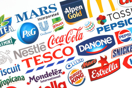 KIEV, UKRAINE - MAY 07, 2015:Collection of popular food logos companies printed on paper:Coca-Cola, Mars, Kraft, Pepsi, McDonalds, Nestle, Tesco and others