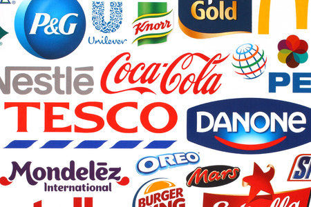 KIEV, UKRAINE - MAY 07, 2015:Collection of popular food logos companies printed on paper:Coca-Cola, Pepsico, Nestle, Tesco and others