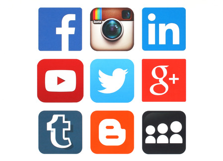 KIEV, UKRAINE - MAY 12, 2015:Collection of popular social media logos printed on paper:Facebook, Twitter, Google Plus, Instagram, MySpace, LinkedIn, YouTube, Tumblr and Blogger Editorial