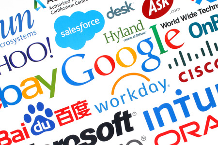 google: KIEV, UKRAINE - MAY 12, 2015:Collection of popular internet companies printed on paper:Google, Yahoo, Adobe, eBay, Microsoft and others on white background