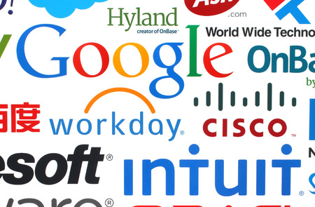 KIEV, UKRAINE - MAY 12, 2015:Collection of popular internet companies printed on paper:Google, Workday, Microsoft, Intuit and others on white background 新聞圖片