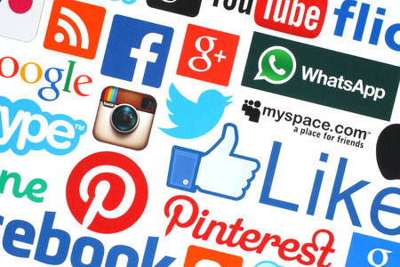 KIEV, UKRAINE - MAY 18, 2015:Collection of popular social media logos printed on paper:Facebook, Twitter, Google Plus, Instagram, Skype, WhatsApp, Pinterest, Blogger and others on white background Editorial