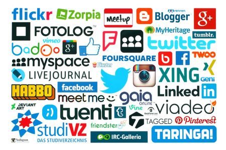 KIEV, UKRAINE - MAY 20, 2015:Collection of popular social media logos printed on paper:Facebook, Twitter, Google Plus, Instagram, Pinterest, Blogger, LinedIn, MySpace and others on white background Imagens - 42130780