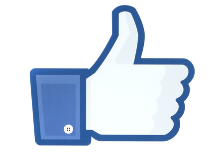 KIEV, UKRAINE - MAY 26, 2015: Facebook thumbs up sign printed on paper. Facebook is a well-known social networking service