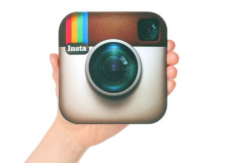instagram: KIEV, UKRAINE - APRIL 29, 2015:Hand holds Instagram logotype printed on paper. Instagram is an online mobile photo-sharing, video-sharing service Editorial