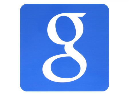 gmail: KIEV, UKRAINE - MAY 26, 2015:Google logotype printed on paper on white background.Google is USA multinational corporation specializing in Internet-related services and products