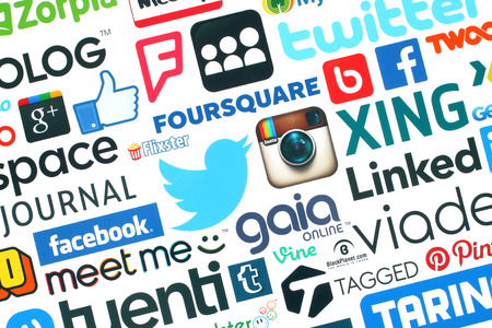 KIEV, UKRAINE - MAY 20, 2015:Collection of popular social media logos printed on paper:Facebook, Twitter, Google Plus, Instagram, Pinterest, Blogger, LinedIn, MySpace and others on white background Editorial