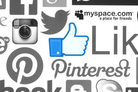 symbol: KIEV, UKRAINE - June 08, 2015:Collection of popular social media logos printed on paper:Facebook, Twitter, Google Plus, Instagram, Skype, WhatsApp, Pinterest, Blogger and others on white background