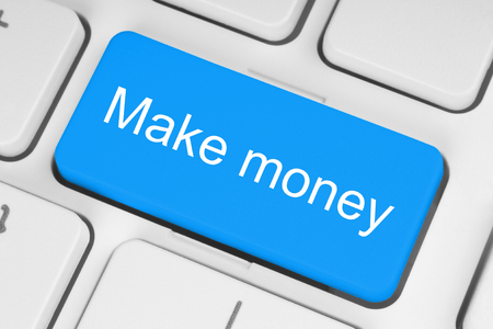 make money: Blue button with make money words on the keyboard close-up