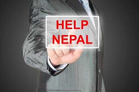 devastating: Businessman pushing virtual help Nepal button on black background
