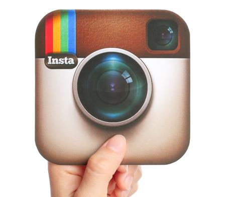 instagram: KIEV, UKRAINE - APRIL 29, 2015:Hand holds Instagram logotype printed on paper. Instagram is an online mobile photo-sharing, video-sharing service.