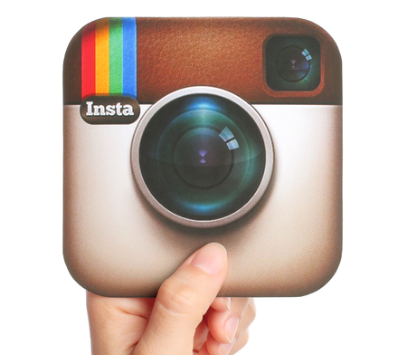 KIEV, UKRAINE - APRIL 29, 2015:Hand holds Instagram logotype printed on paper. Instagram is an online mobile photo-sharing, video-sharing service.