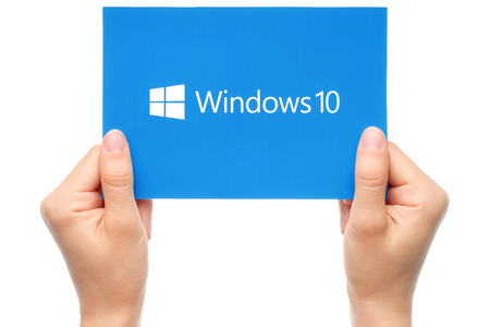 KIEV, UKRAINE - AUGUST 18, 2015:Hand holds Windows 10 logotype printed on paper. Windows 10 is an operating system developed by Microsoft. Editorial
