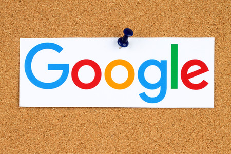 google: KIEV, UKRAINE - SEPTEMBER 02, 2015:New Google logotype printed on paper, cut and pinned on cork bulletin board.Google is USA multinational corporation specializing in Internet-related services.