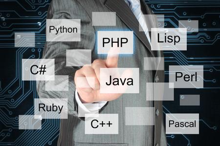 Man pushing virtual programming language button on digital background