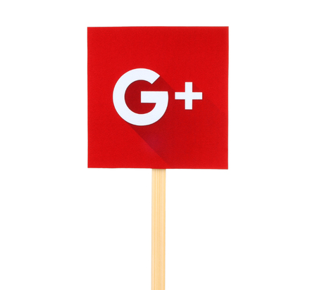 google: Kiev, Ukraine - October 07, 2015: New Google Plus logo sign printed on paper, cut and pasted on wooden stick. Google is USA multinational corporation.