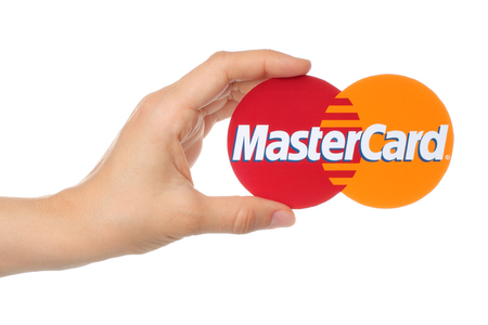mastercard: Kiev, Ukraine - August 18, 2015: Hand holds Mastercard logo printed on paper on white background. MasterCard Worldwide is an American multinational financial services corporation. Editorial