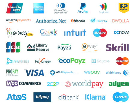 Kiev, Ukraine - January 11, 2016: Collection of popular payment system logos printed on white paper:PayPal, Google Wallet, Bitcoin, Mastercard, Maestro, Skrill, JCB, Payoneer, Visa, Worldpay and other Редакционное
