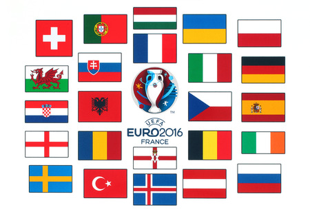 football european championship: Kiev, Ukraine - January 26, 2016: Official logo of the 2016 UEFA European Championship in France with flags of the countries participants printed on white paper