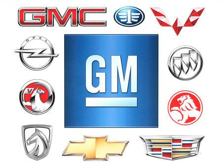 general: KIEV, UKRAINE - February 1, 2016:Brands of General Motors Company printed on paper. General Motors Company is an American multinational corporation that designs, manufactures and distributes vehicles. Editorial