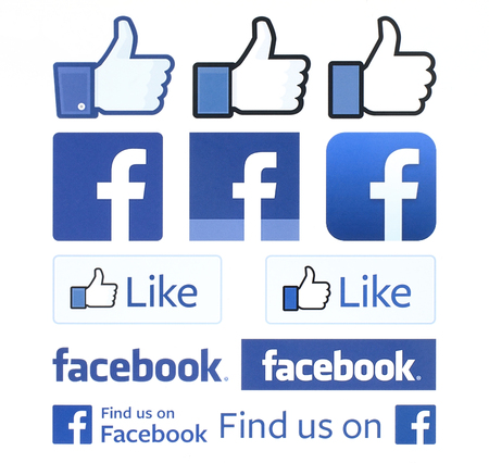 Kiev, Ukraine - February 4, 2016: Facebook logos and thumbs up printed on white paper. Facebook is a well-known social networking service.